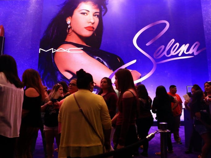 Fans stand in line as they wait to pay for their MAC Selena makeup collection during the World Premiere on Friday, Sept. 30, 2016, at the American Bank Center in Corpus Christi.