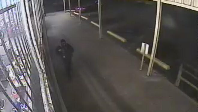 Image captured from Friday night's robbery of a west Shreveport Family Dollar.