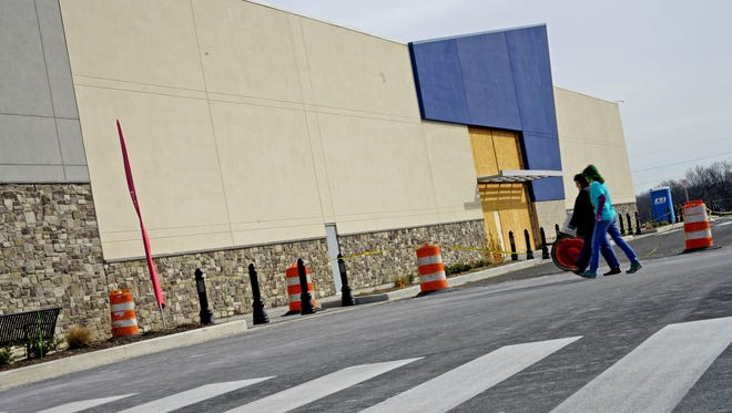 Shoppers walk to the DSW shoe store next to the future home of a Best Buy moving to the Christiana Fashion Center. The new store will is slated to open this summer.