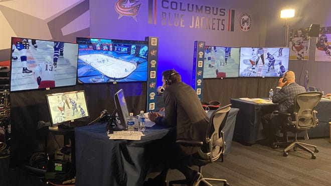 Jody Shelley, left, the color analyst for the Columbus Blue Jackets, and Jeff Rimer, play-by-play announcer, call Tuesday's game against the Toronto Maple Leafs. Because of the coronavirus and the NHL's hub model, they're calling games from Nationwide Arena despite the game being in Toronto.