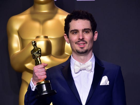 Damien Chazelle wins the Oscar for Best Director during