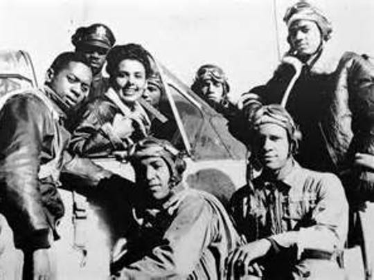 Group of Tuskegee Airmen pose.