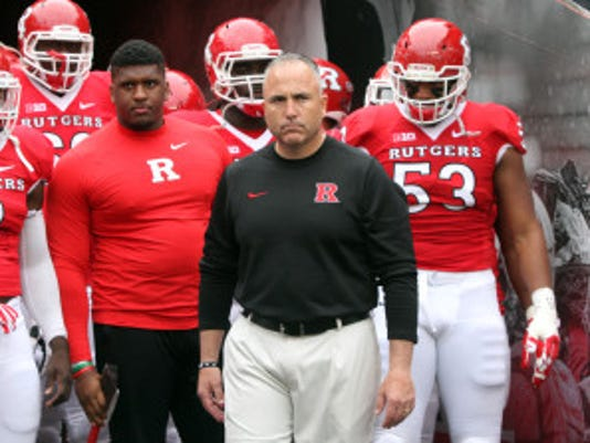 The Rutgers Scarlet Knights take on the Terrapins of the University of Maryland in the season finale of Big Ten football season at High Point Solutions Stadium in Piscataway on Saturday November 28,2015. Here Rutgers head football coach Kyle Flood (center) gets ready to bring his team out of the tunnel for what might the last time as head coach, as Rutgers loses to Maryland 41-46.