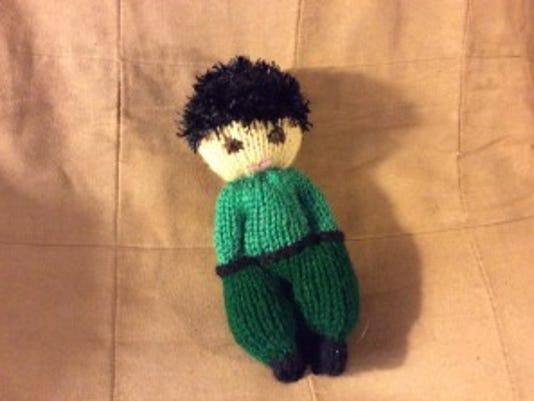 In addition to having feet pointing forward, this little guy  has hair made with eyelash yarn, rather than regular yarn or fir. I think eyelash yarn looks the best.