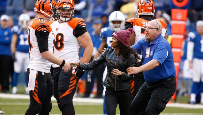 A rogue fan approached the Cincinnati Bengals quarterback Andy Dalton (14) on the final drive of the game against the Indianapolis Colts at Lucas Oil Stadium.  The Enquirer/Jeff Swinger