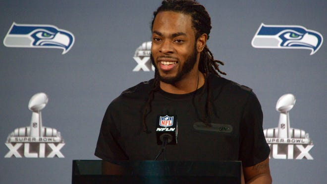 Seahawks CB Richard Sherman knows how to work a crowd from the podium.