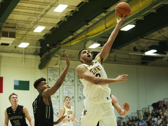 Vermont's Anthony Lamb (3) leaps for a lay up during the men's basketball game between the Dartmouth Big Green and the Vermont Catamounts at Patrick Gym on Dec. 7, 2016 in Burlington