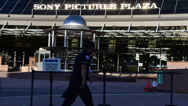 """A security guards passes the entrance to Sony Pictures Plaza in Los Angeles on Dec. 4, a day after Sony Pictures denounced a """"brazen"""" cyberattack it said netted a """"large amount"""" of confidential information, including movies as well as personnel and business files,"""