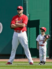Abilene High's John Lackey is pictured with his son Carter before a game in 2015. Now retired, Lackey helps out coaching Carter's little league team.