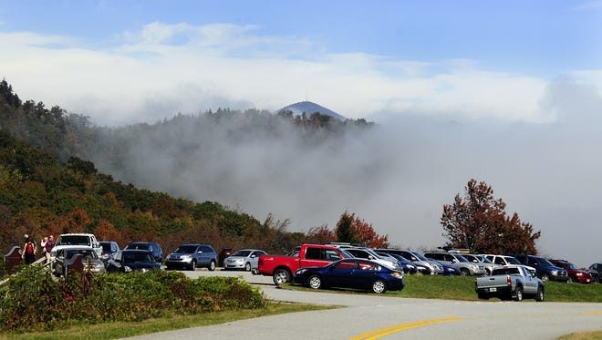 Mount Pisgah rises above the parking area at Graveyard Fields on the Blue Ridge Parkway.