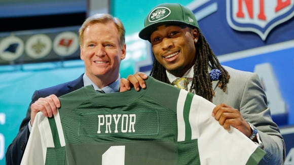 Louisville free safety Calvin Pryor poses with NFL commissioner Roger Goodell after being selected by the New York Jets as 18th pick in the the first round of the 2014 NFL Draft, Thursday, May 8, 2014, in New York. (AP Photo/Craig Ruttle)