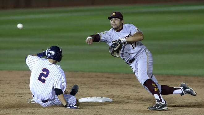 ASU's short stop Drew Stankiewicz is off balance as he turns a double play as Arizona's Kevin Newman is out as he slides into second base to end the first inning at Hi Corbett Field.