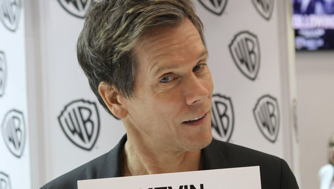 """""""The Following"""" star Kevin Bacon is in the Warner Bros. booth during Comic-Con 2013 on July 19, 2013 in San Diego, California."""