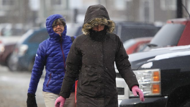 File Photo: East Avenue Wegmans shoppers were dressed for the frigid cold and blowing snow this winter day.