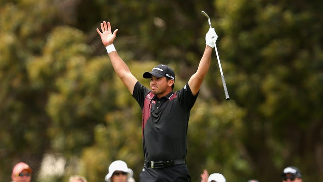 Jason Day of Australia celebrates gettting an eagle on the 6th hole during day four of the World Cup of Golf at Royal Melbourne Golf Course on November 24, 2013 in Melbourne, Australia.