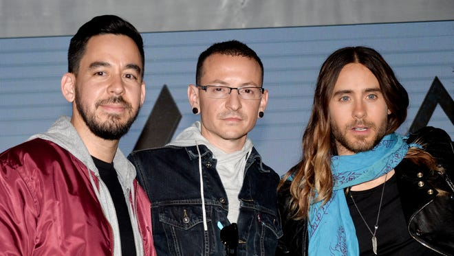 From left, musicians Mike Shinoda and Chester Bennington of Linkin Park and Jared Leto of Thirty Seconds to Mars announce their summer tour at a press conference Tuesday in Los Angeles.