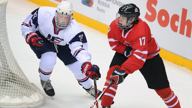 USA forward Jack Eichel defends against Canada's forward Connor McDavid last spring. The two are expected to go first and second in the 2015 draft.
