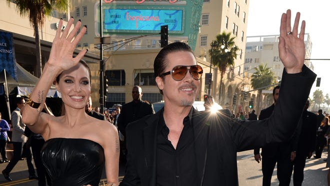 "Angelina Jolie and Brad Pitt attend the World Premiere of Disney's ""Maleficent"" on May 28 in Hollywood, Calif."