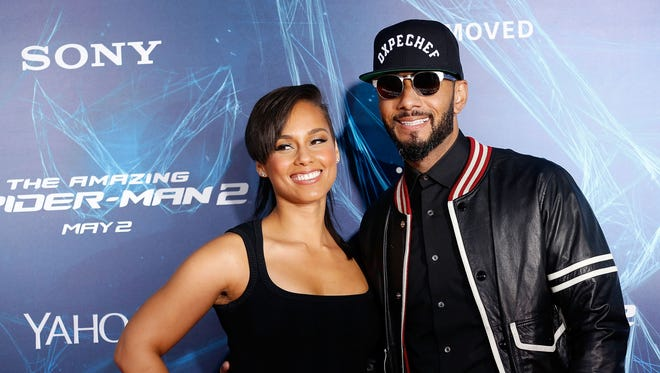 """Alicia Keys and musician Swizz Beatz attend """"The Amazing Spider-Man 2"""" premiere at the Ziegfeld Theater on April 24, 2014 in New York City."""
