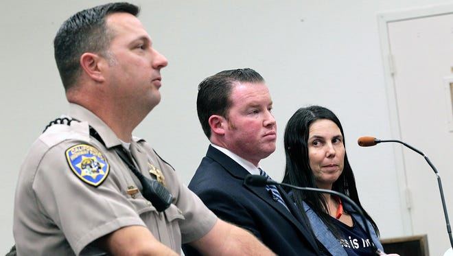 California Highway Patrol office Keith Odle, left, attorney William M. Concidine, center, along with Cecilia Abadie, right, speak during a news conference, Thursday, Jan. 16, 2014, in San Diego.