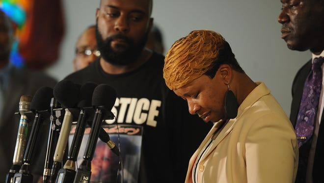 Lesley McSpadden, mother of slain 18-year-old Michael Brown, is overcome with emotion during a press conference.
