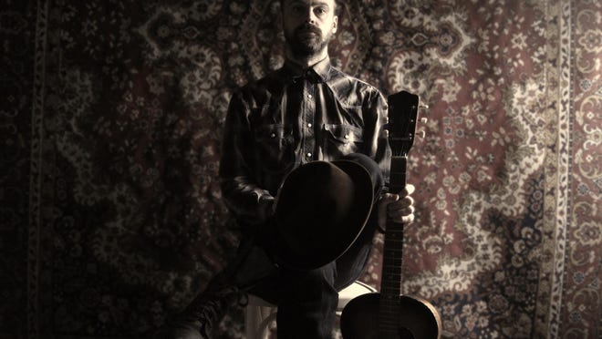 "Silas J. Dirge released an album and two singles of ""dark country"" music with eerie titles such as ""Tales of Woe"" and ""Flowers on her Grave."""