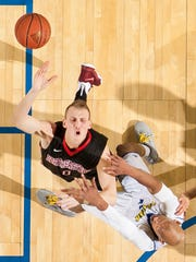 Northeastern's Alex Murphy loses the ball as he collides with Delaware's Barnett Harris (right) in the second half of the University of Delaware's 69-62 win over Northeastern University at the Bob Carpenter Center in Newark on Thursday night.