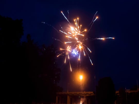 Fireworks explode in synchronization with patriotic