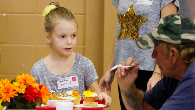 Sophia Gerbara, 8, was among the volunteers serving Thanksgiving dinner Thursday at the Salvation Army in Fort Myers. Sophia has volunteered on Thanksgiving since she was 5-years-old.