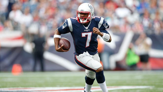 New England Patriots quarterback Jacoby Brissett (7) carries the ball during the fourth quarter against the Miami Dolphins at Gillette Stadium.