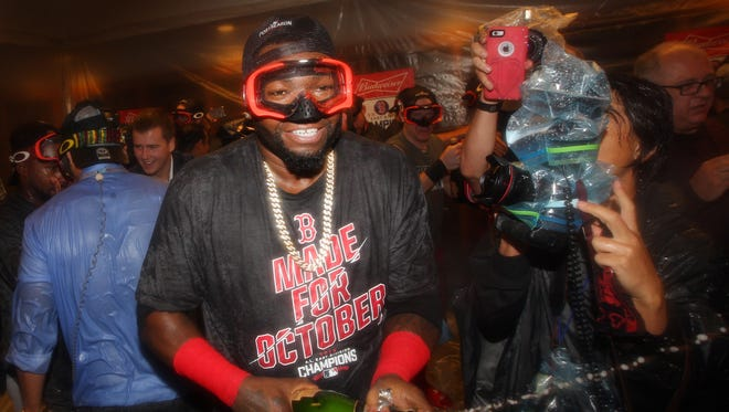 Red Sox designated hitter David Ortiz celebrates with teammates clinching their division with a Blue Jays loss.