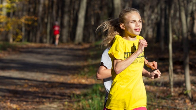 Ava Strenge of St. Philip runs at the Ott Biological Preserve in October 2014.