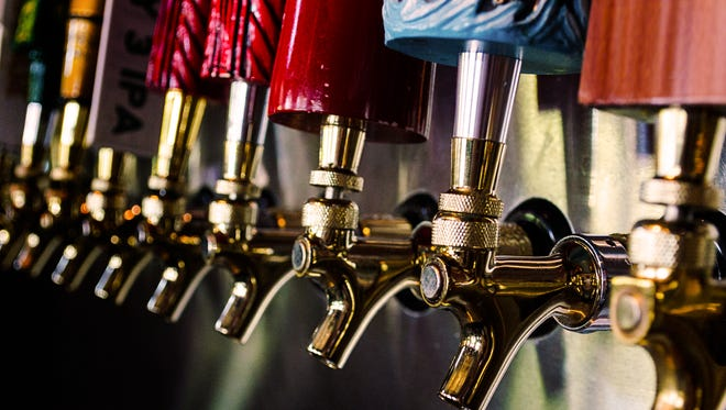 Close up of a line of draft beer taps.