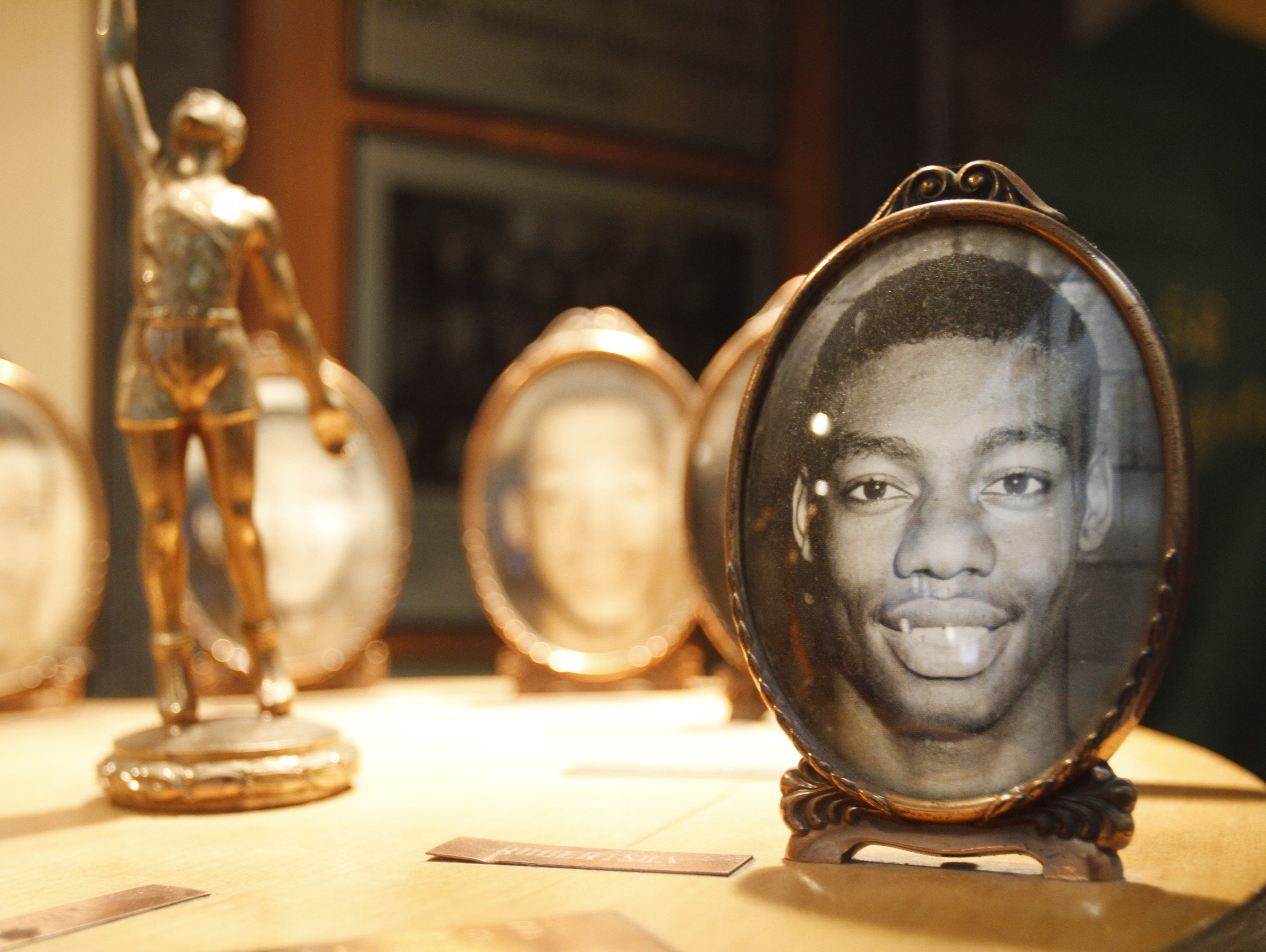 This is a collection of framed portraits of Oscar Robertson and his Attucks team at Indiana Basketball Hall of Fame in New Castle.