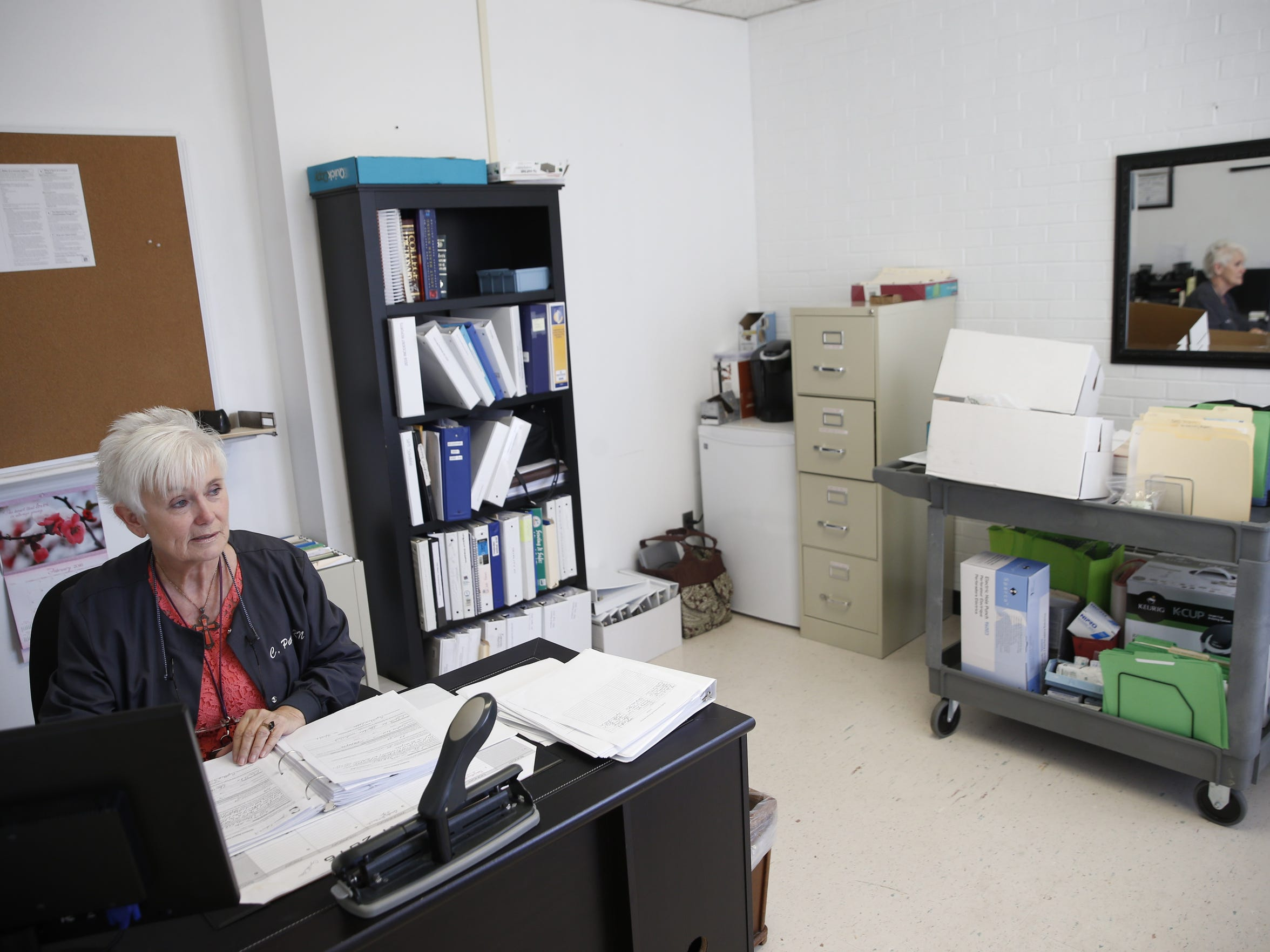 Compliance Officer and Risk Manager Cynthia Pettis works in her office at Calhoun Liberty Hospital, where she started work a month ago, soon after the hospital's previous CEO Phillip Hill began being investigated in connection with a more than $1 million fraud scheme.