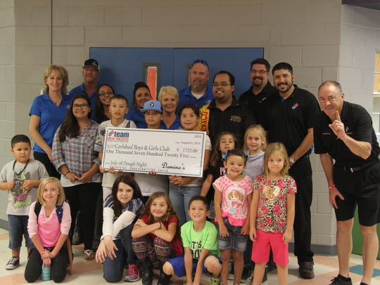Domino's Pizza in Carlsbad donated $1,725 to the local