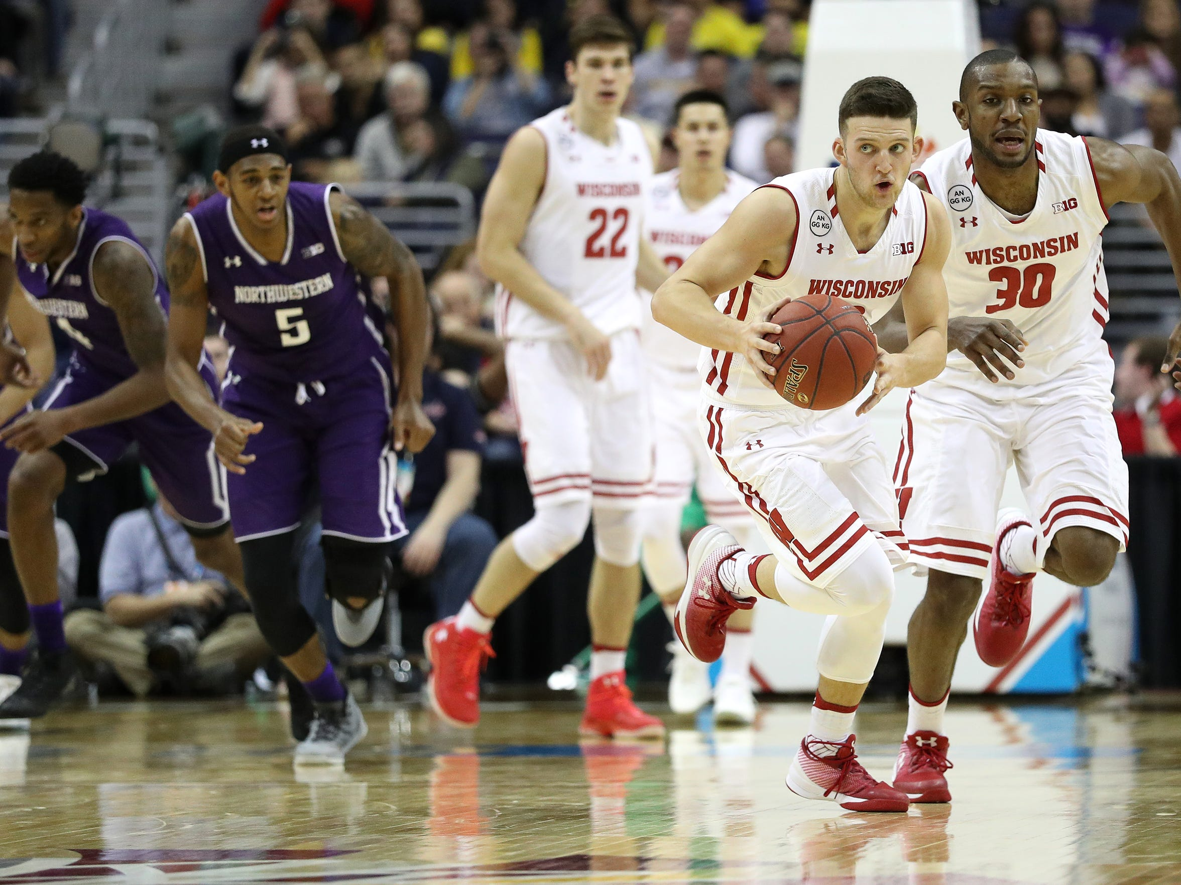 Wisconsin guard Zak Showalter dribbles up the court