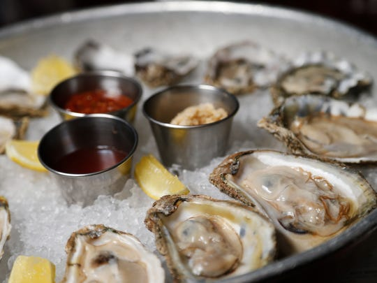 The seasonal raw oysters are served with horseradish, cocktail and mignonette sauces Wednesday, Dec. 6, 2017, at Django in Des Moines.