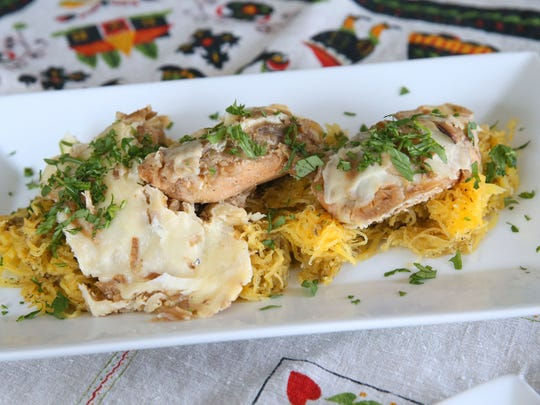 French onion chicken is served over spaghetti squash.