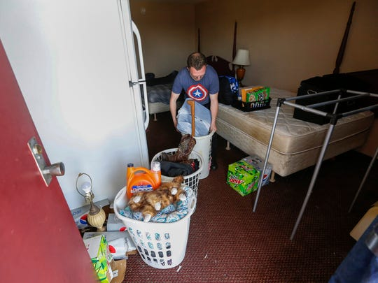Paul Bowen gathers his belongings out of his room at the 76 Inn in Branson on Wednesday, April 18, 2018. Bowen said he was going to move in with his father.