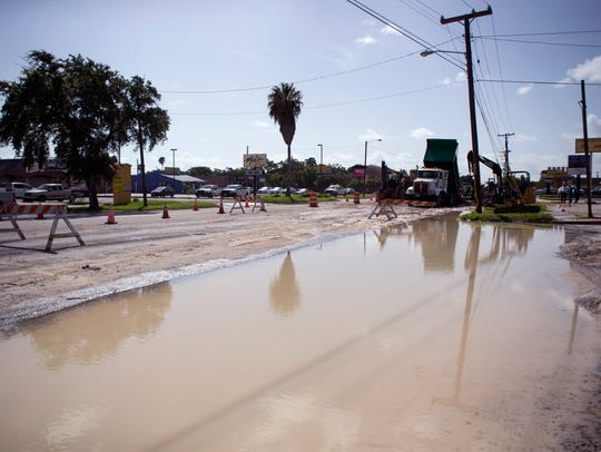 The city repairs a water main break on Alameda Street