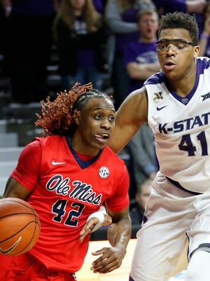 Ole Miss' Stefan Moody drives around Kansas State's Stephen Hurt on Saturday.