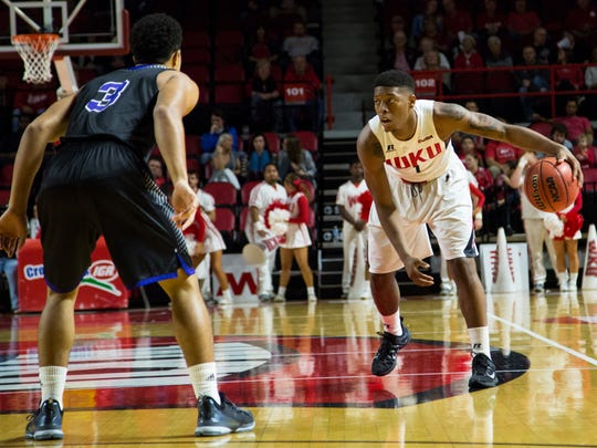 WKU freshman guard Chris McNeal stays in touch with South Side coach DaMonn Fuller and the current Hawks.