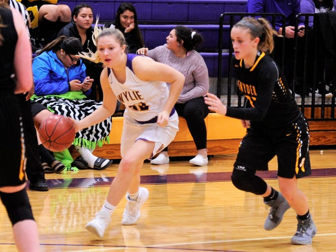 Wylie's Skylar Williams drives into the lane during
