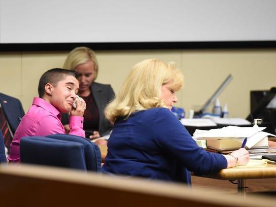 Erica Witt reacts alongside her attorney, Virginia