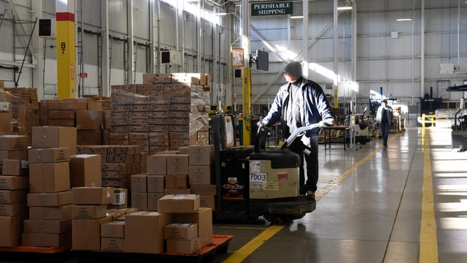 Brian Hodge operates a Pallet Jack at the Harry & David distribution center in Hebron in this file photo.
