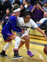 Spanish Springs' Autumn Wadsworth dribbles past Reno's Mikayla Shults during Tuesday's game at Spanish Springs.