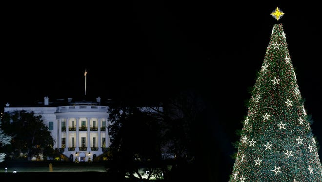 With the White House in the background, the National Christmas Tree is lit during the lighting ceremony on the Ellipse in 2012.