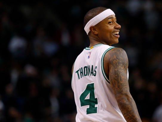 Boston Celtics guard Isaiah Thomas (4) smiles during