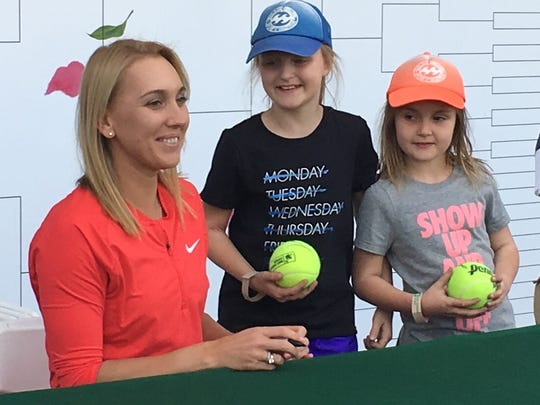 Defending BNP Paribas Open champion Elena Vesnina signs autographs and takes pictures with fans during the women's draw ceremony Monday.